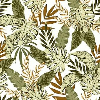 緑の植物と葉を持つ熱帯のシームレスパターン