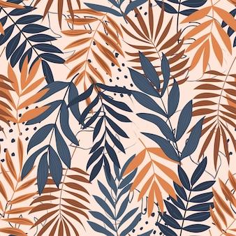 熱帯の葉と明るい色のトレンドシームレスパターン
