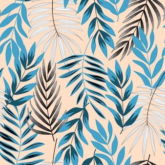 熱帯の葉とトレンドの抽象的なシームレスパターン