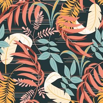 植物の葉と抽象化とカラフルな熱帯のシームレスパターン
