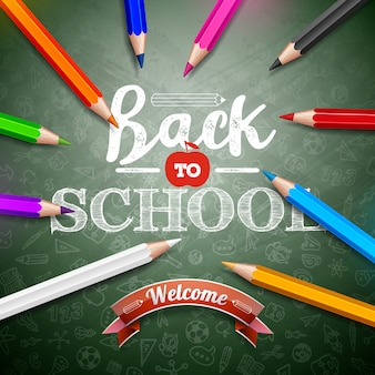カラフルな鉛筆と緑の黒板背景にタイポグラフィレタリングで学校に戻る