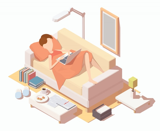 Девушка с ноутбуком, работающих на дому на диване.