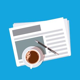 Чашка кофе и ручка на газете.