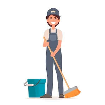制服を着たクリーナーの女性が床を掃除します。
