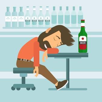酔っ払った男性がパブで眠っている