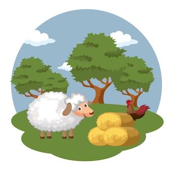 干し草のベールの横にある羊とオンドリ
