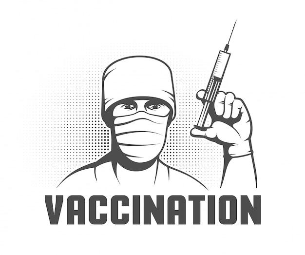 手に注射器を持つ医師
