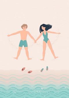 幸せな男と女はビーチの図にうそをつく