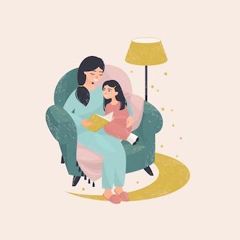 Молодая мама на ночь читает дочери книгу