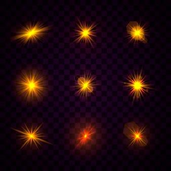 イエローゴールドの輝く光のセットが透明で爆発する