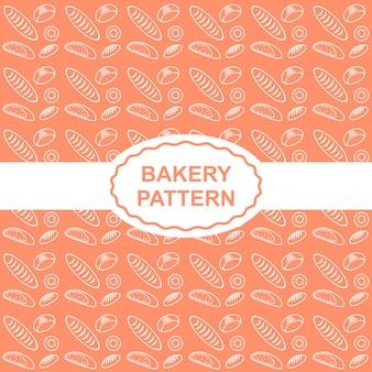 オレンジ色の背景のパンとパンのシームレスなパターン。