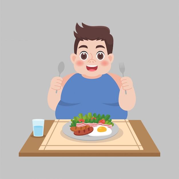 デブ男が食べ物を食べる準備ができて