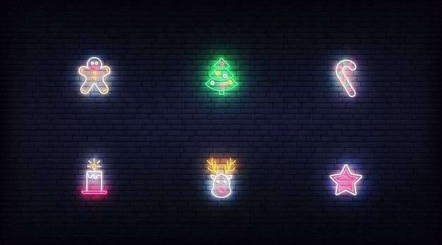 Рождественские неоновые элементы. вектор светящиеся неоновые красочные символы