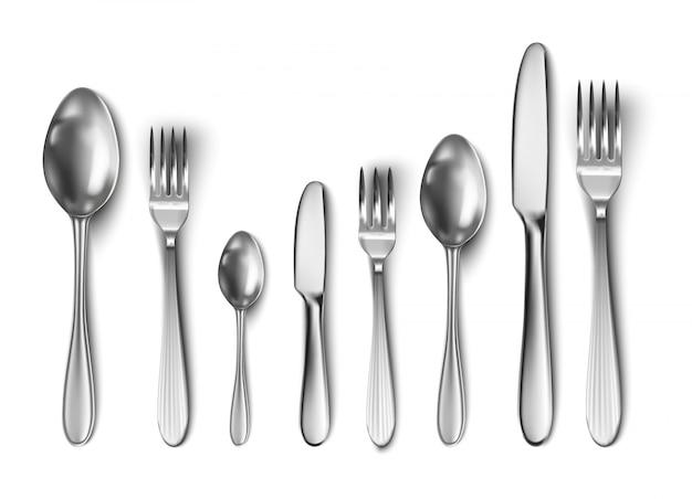 Набор столовых приборов со столовым ножом, ложкой, вилкой, чайной ложкой и рыбной ложкой.