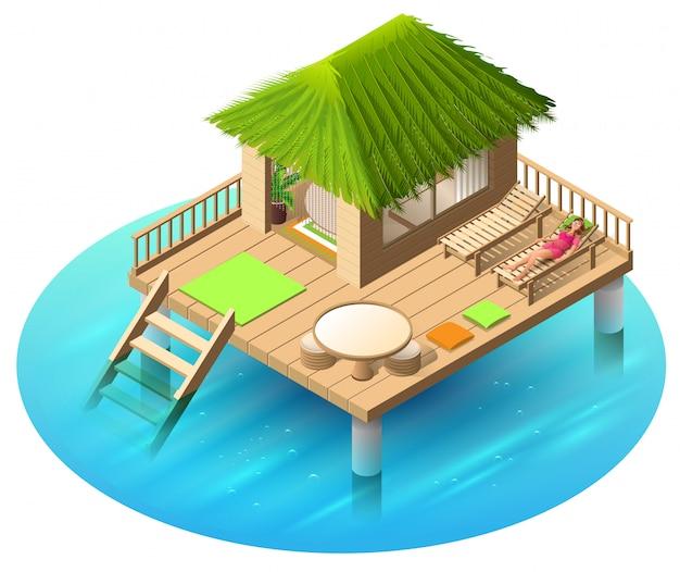 水と女性の熱帯バンガローはデッキチェアにあります