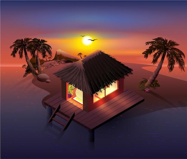 夜の熱帯の島。ヤシの木とビーチの小屋
