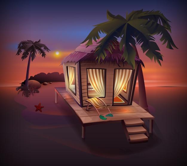夜の熱帯の島。海岸のヤシの木の中でわら小屋