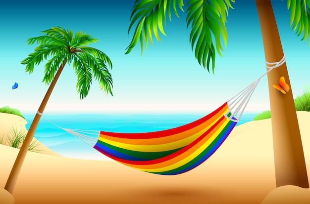 Радуга полосатый гамак на пляже между пальмами. летние каникулы