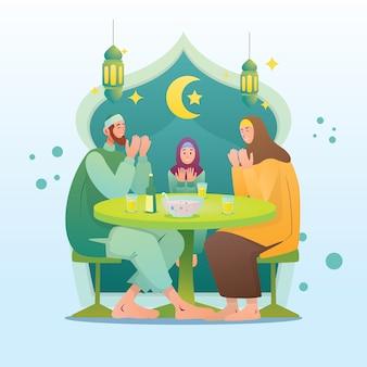 イスラム教徒の家族がイラストを食べる前に祈る