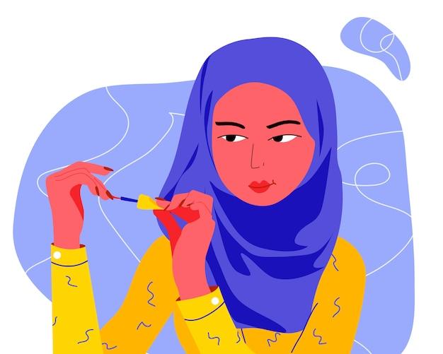 若いイスラム教徒の女性は彼女の爪をペイントします