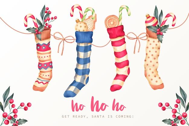 Рождественский фон с зимними носками и конфетами