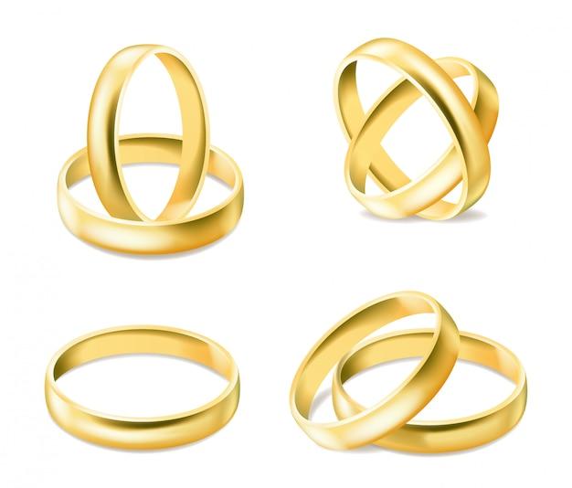 Набор золотых обручальных колец на белом фоне