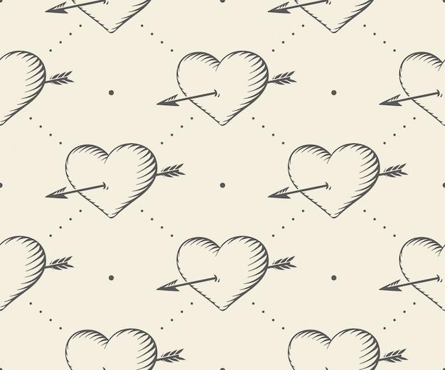 心とバレンタインスタイルの彫刻のビンテージスタイルの矢印とのシームレスなパターン。