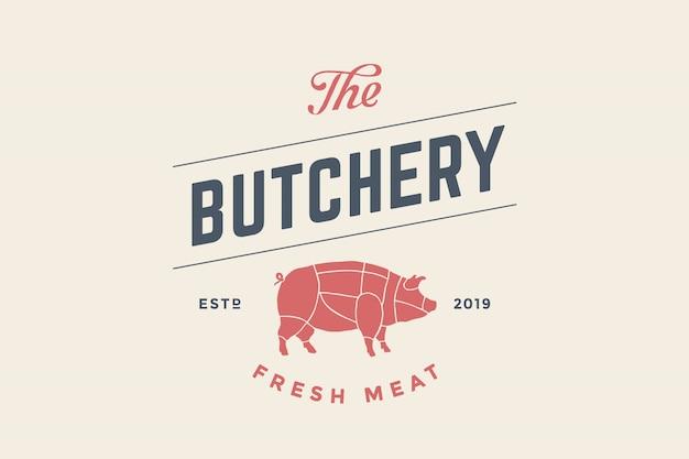 豚のシルエットと精肉店のエンブレム