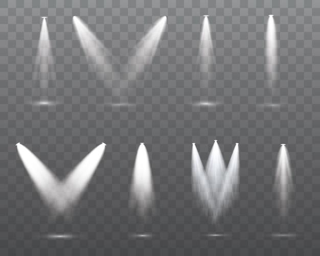 白いスポットライトのセットは、ステージ、シーン、表彰台に輝いています。ランプまたはスポットライトからの専用レンズフラッシュライト効果。