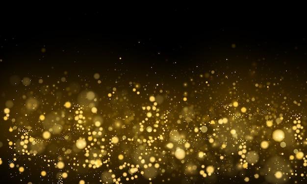 ゴールドのボケ効果と抽象的な背景。ダスト粒子。