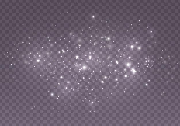 ほこりの火花と金色の星が特別な光で輝きます。ボケ効果と抽象的な背景。