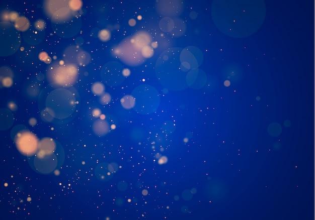 暗い青色の背景にぼけボケライト。抽象的なキラキラデフォーカス点滅星と火花。