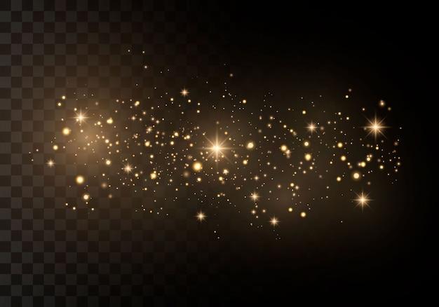 火花と金色の星が特別な光で輝きます。きらめく魔法の塵の粒子。
