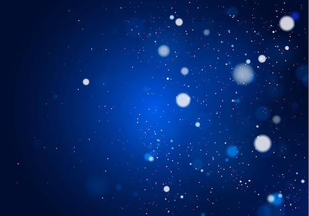 Затуманенное боке свет на синем фоне. и новогодние каникулы шаблон. абстрактный блеск расфокусированным мигающие звезды и искры.
