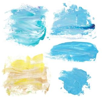 青と金色の大理石の塗料が飛び散る。大理石の背景テクスチャ