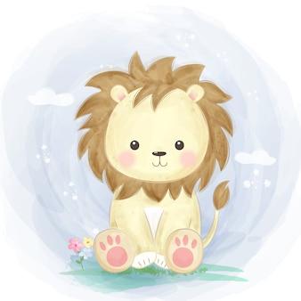 Милый ребенок лев в саду