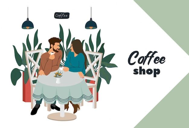 テーブルに座っている訪問者の若いカップルとコーヒーショップ