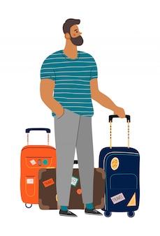 スーツケースを持って待っている男。
