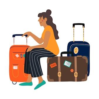 スーツケースで待っている女性。