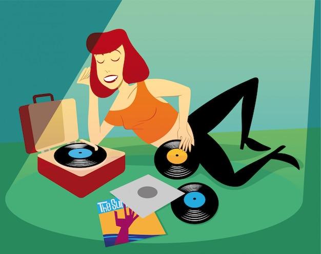 Девушка слушает виниловые пластинки укладки и отдыха на полу