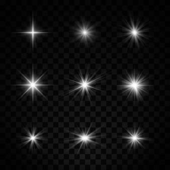 ほこりと輝きの白い星のセット。光の効果。
