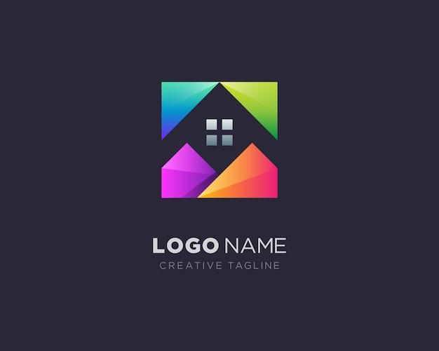 創造的なカラフルな家のロゴ