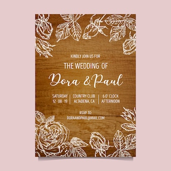 木製の背景を持つ結婚式の招待状