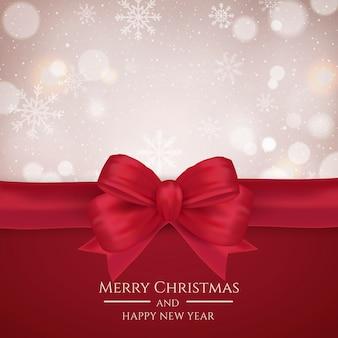 赤の弓と焦点の合っていないクリスマスの背景