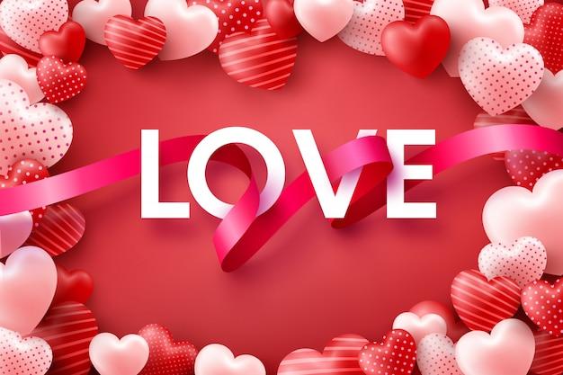 愛とバレンタインデーの背景に単語「愛」のリボンとピンクの甘い心