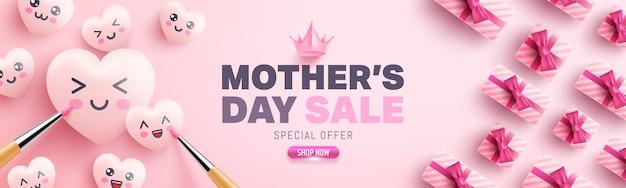 Плакат продажи дня матери с коробкой подарков, милыми сердцами и мультипликационной росписью смайликов на розовом фоне. шаблон для продвижения и покупок или фон для концепции любви и дня матери