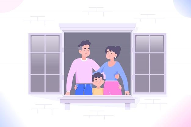 Семья сидит дома и смотрит в окно