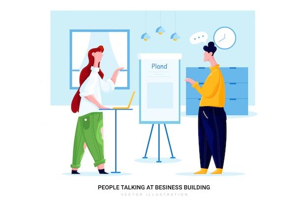 ビジネスビルディングで話している人々