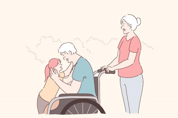 Инвалид, семейный уход. неработающий постаретый человек в кресло-коляске гуляя с семьей в парке, счастливая внучка обнимая деда с ограниченными возможностями, уход и помощь. простая квартира