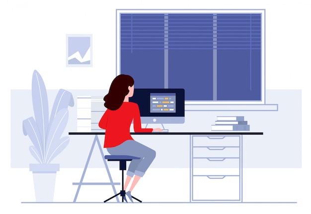 Рабочее место в офисе, деловая женщина работает на компьютере за партой